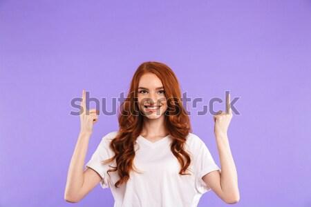 Portret vrolijk jong meisje permanente geïsoleerd violet Stockfoto © deandrobot