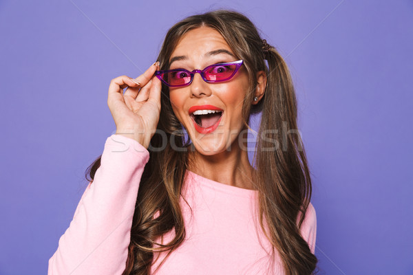Portrait of a cheerful girl in sweatshirt in sunglasses Stock photo © deandrobot