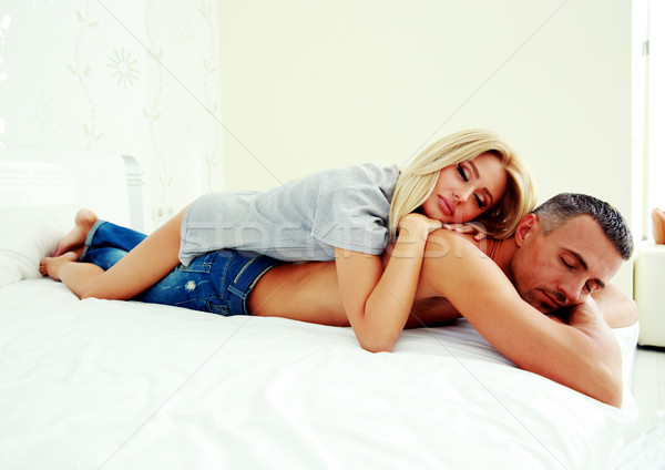 Young couple relaxing on the bed Stock photo © deandrobot