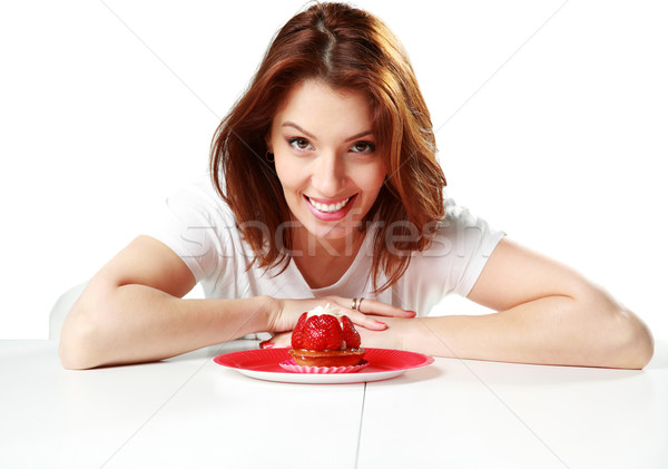 Smiling woman sitting on the table with fresh strawberry cake isolated on a white background Stock photo © deandrobot