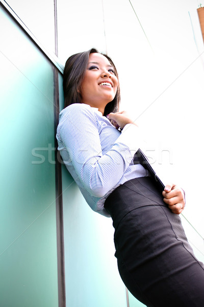 A pretty asian business woman at the office building  Stock photo © deandrobot