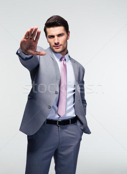 Businessman showing stop gesture Stock photo © deandrobot