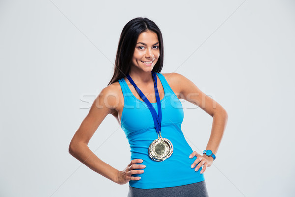 Portre gülen fitness woman madalya ayakta gri Stok fotoğraf © deandrobot