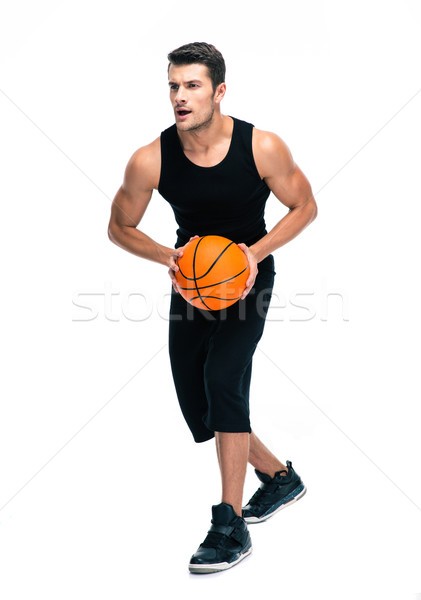 Full length portrait of a man playing in basketball Stock photo © deandrobot