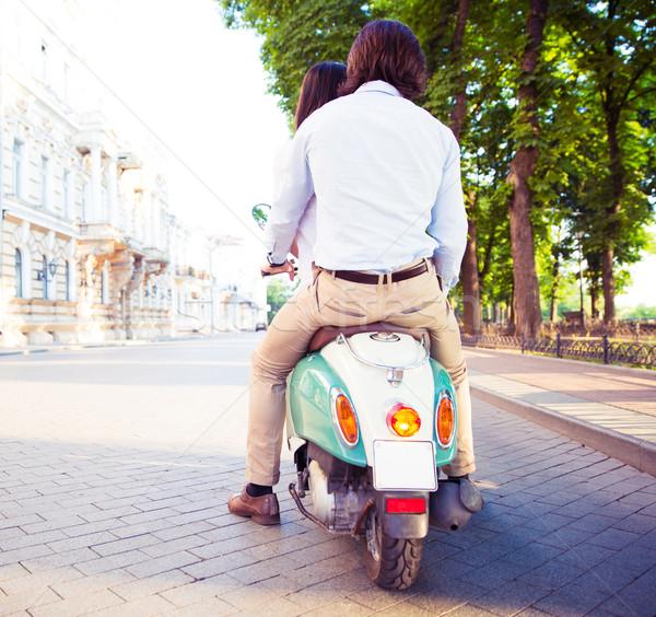 Hátulnézet fiatal pér moped város nők férfiak Stock fotó © deandrobot