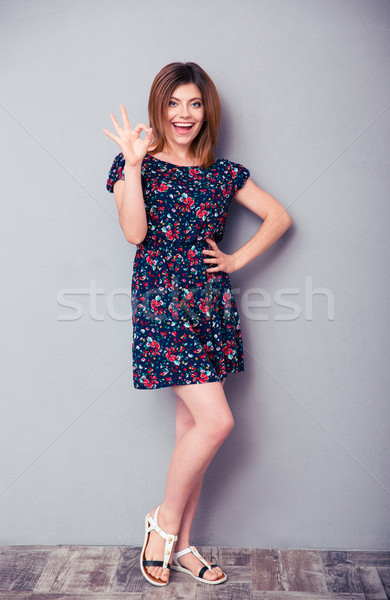 Cheerful young girl showing ok sign  Stock photo © deandrobot