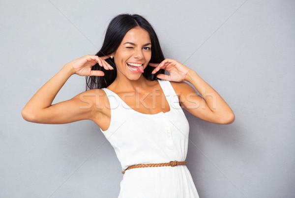 Vrouw grappig jonge vrouw grijs Stockfoto © deandrobot