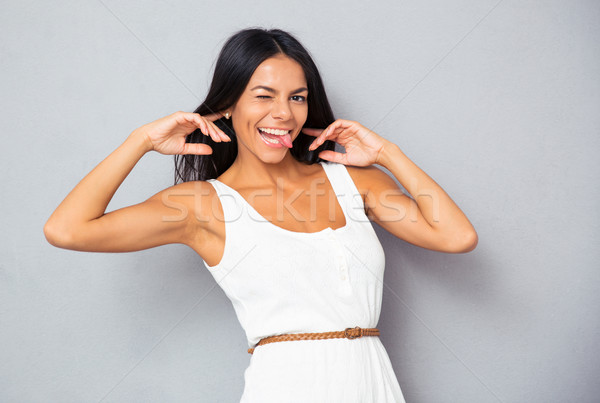 Mulher engraçado mulher jovem cinza Foto stock © deandrobot