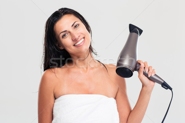 Woman in towel holding hairdryer  Stock photo © deandrobot