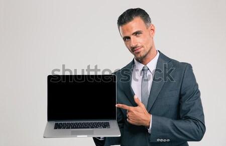 Işadamı dizüstü bilgisayar ekran portre yakışıklı Stok fotoğraf © deandrobot
