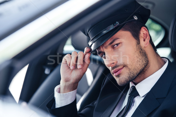 Handsome male chauffeur sitting in a car Stock photo © deandrobot