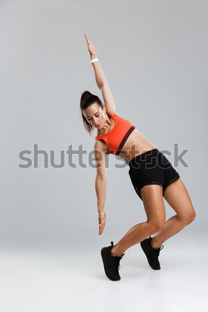 Young flexible woman gymnast  Stock photo © deandrobot