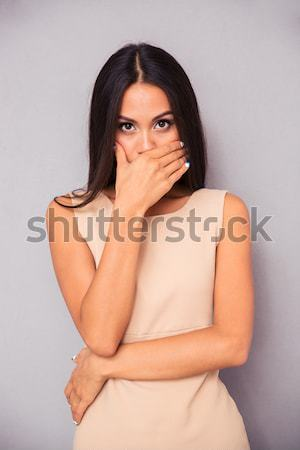 Portrait of a thoughtful woman in dress looking up Stock photo © deandrobot