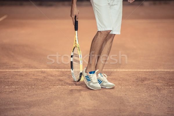 Male legs with tennis racket  Stock photo © deandrobot