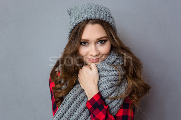 Smiling cute woman with scarf and hat Stock photo © deandrobot