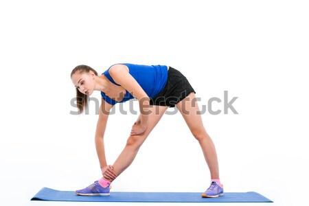 Sports woman doing warm up exercises Stock photo © deandrobot