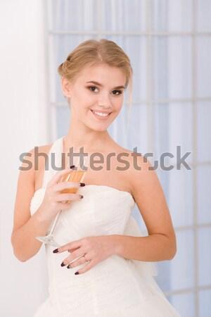 Menyasszony áll fehér esküvői ruha portré boldog Stock fotó © deandrobot