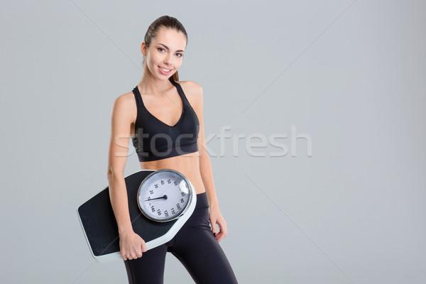 Piękna uśmiechnięty młodych kobieta fitness dres Zdjęcia stock © deandrobot