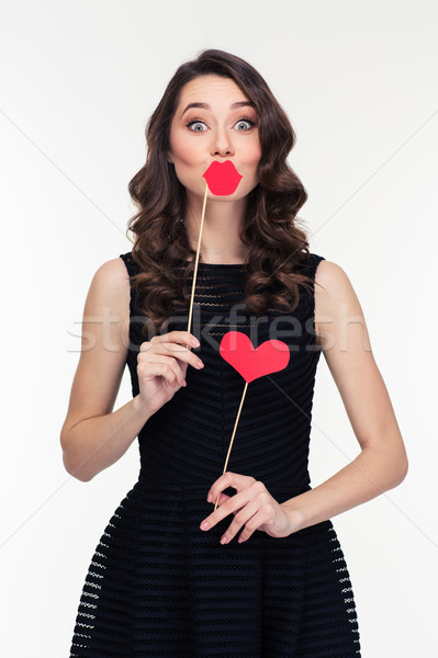 Funny female using fake lips and heart props on sticks  Stock photo © deandrobot