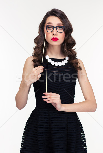 Amusing curly woman posing with fake beads and glasses booth  Stock photo © deandrobot