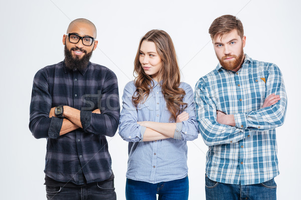 Two confident men and one woman standing with arms crossed  Stock photo © deandrobot