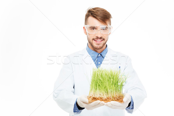 Happy male engineer showing a modified plants Stock photo © deandrobot