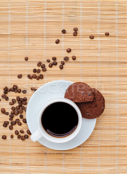 Chocolate cookies and cup of coffee on the table Stock photo © deandrobot