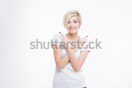 Smiling woman standing with crossed hands Stock photo © deandrobot