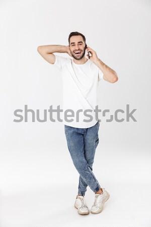 Feliz forte moço em pé bíceps Foto stock © deandrobot