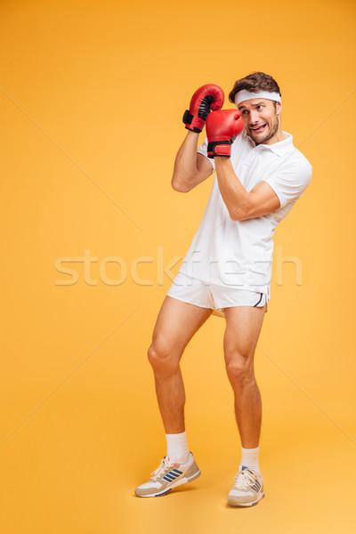 Ijedt férfi boxoló piros kesztyű fedett Stock fotó © deandrobot