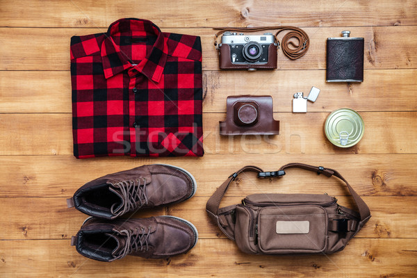 Travel concept boots, shirt, camera, lighter, flask, bag Stock photo © deandrobot