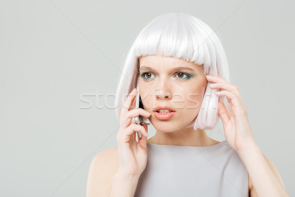 Zamyślony zmartwiony kobieta peruka mówić Zdjęcia stock © deandrobot