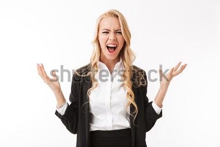 Amazed blonde woman looking at camera Stock photo © deandrobot