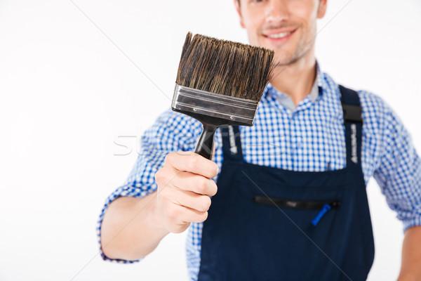 Obraz uśmiechnięty mężczyzna budowniczy pędzlem Zdjęcia stock © deandrobot