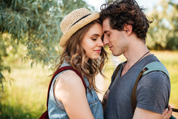 Close up portrait of an attractive couple in love embracing Stock photo © deandrobot