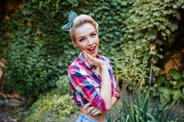 Feliz maravilhado pin para cima menina em pé Foto stock © deandrobot