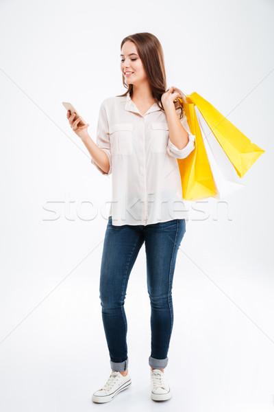Stok fotoğraf: Mutlu · genç · kadın · cep · telefonu · tam · uzunlukta