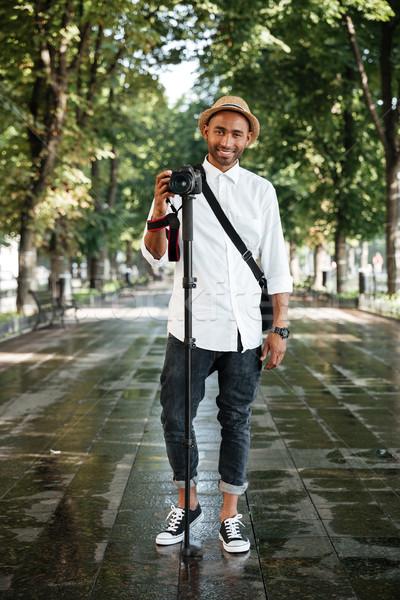 Full length portrait of black man in park Stock photo © deandrobot