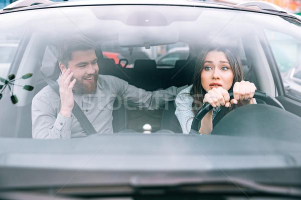 Csinos nő férfi autó lány kerék néz Stock fotó © deandrobot