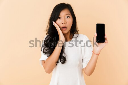 Shocked man holding virtual reality device Stock photo © deandrobot