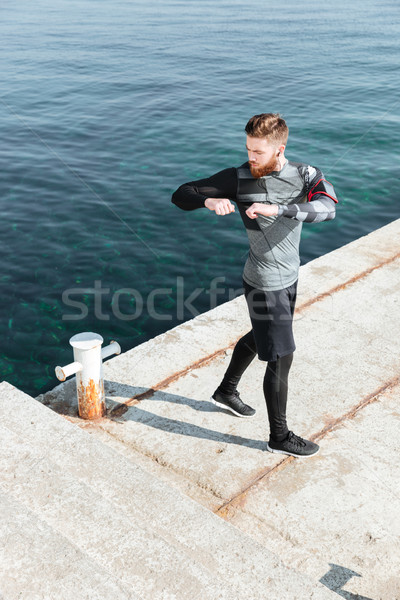Man warming up in harbor Stock photo © deandrobot