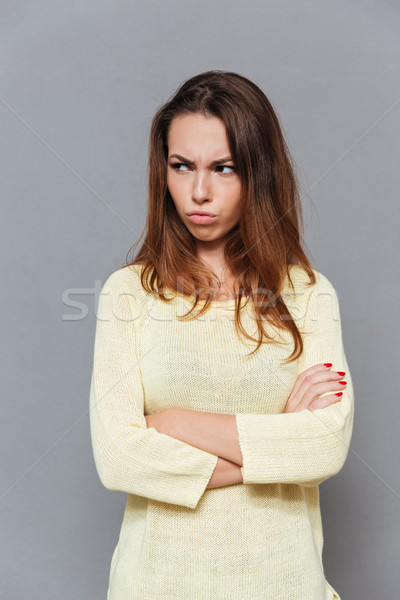 Portrait of angry upset woman standing with arms crossed Stock photo © deandrobot