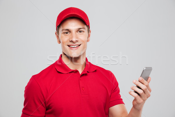курьер телефон глядя камеры портрет Сток-фото © deandrobot