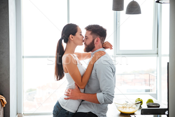 ?ouple cuddling and kiss Stock photo © deandrobot