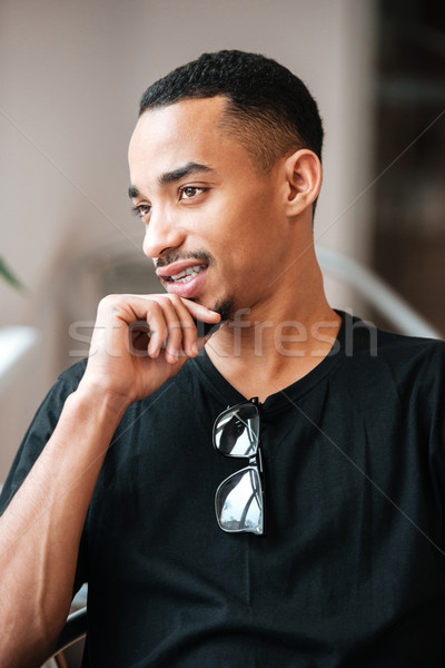 Portrait of a thoughtful young afro american man indoors Stock photo © deandrobot