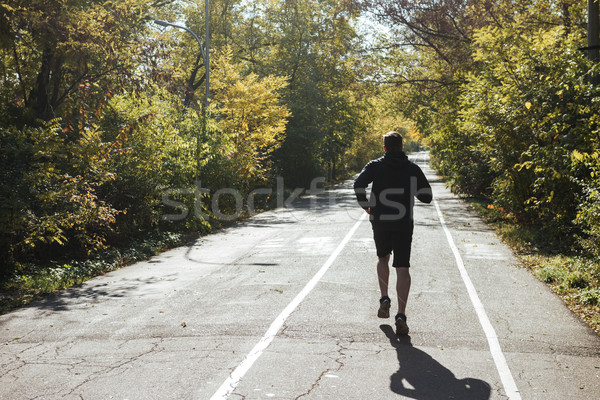 Back view of young runner in park Stock photo © deandrobot