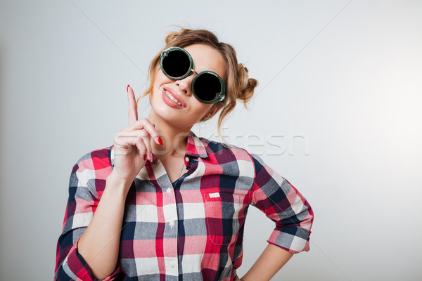 Funny Woman in shirt and sunglasses Stock photo © deandrobot