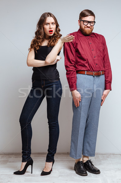 Stock photo: Vertical image of Pretty woman with Male nerd