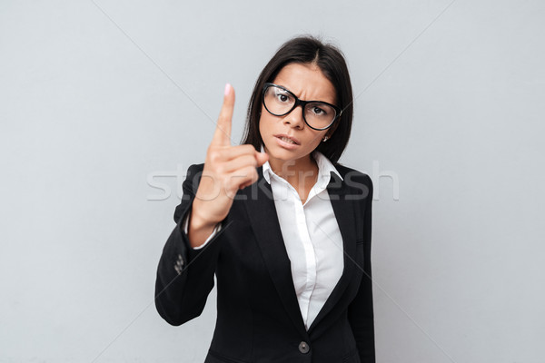 Business woman showing finger as no decline or refuse gesture Stock photo © deandrobot