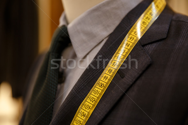Close up shot of men suit jacket on hanger Stock photo © deandrobot
